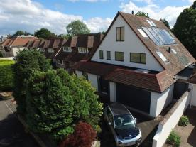 Both the solar thermal collectors and the PV panels are from the same supplier, Viridian Solar, and are designed to look nearly exactly the same. (Photo: Solar Kingdom Ltd)